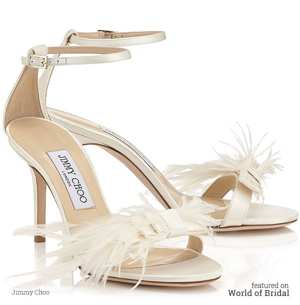 This bridal shoe follows the current Red Carpet trend of a simple strappy sandals with immaculate detailing. The look is finished with an intricate feathered bow across the strap of the upper and delicate strap with buckle detailing around the ankle for added support. The upper is beautiful ivory satin.