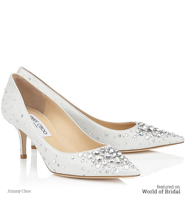 The Aurora pointy toe pump is characterized by its clean, simple silhouette. It is leather lined with a leather sole and finished with a white shimmer suede with multi crystals upper.
