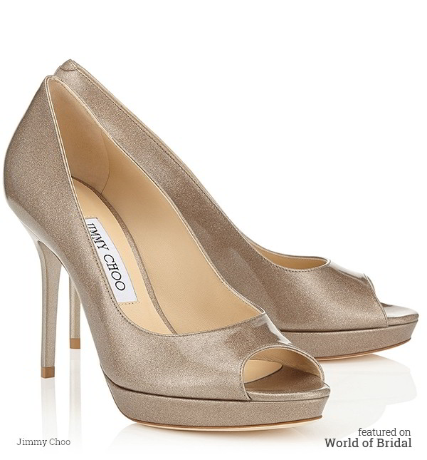 A versatile and contemporary peep toe platform pump. Leather lined with a leather sole, and finished with a glitter patent leather upper.